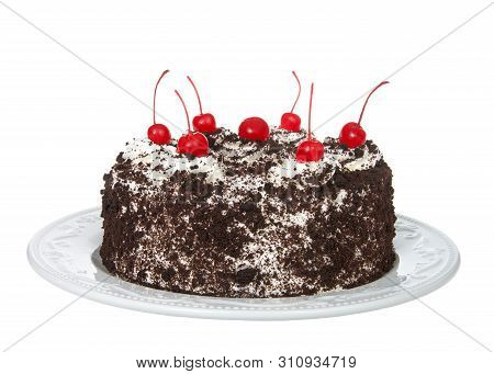Whole Black Forest Cake On An Off White Porcelain Plate Isolated On A White Background. Whipped Crea