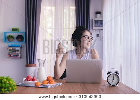 Young Asian Woman Drinking Milk, Kitchen Table, Young Asian Lifestyle.