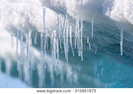 Icicles hanging from the base of the ice shelf in Svalbard, a Norwegian archipelago between mainland Norway and the North Pole.