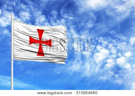 National Flag Of Templiers On A Flagpole In Front Of Blue Sky