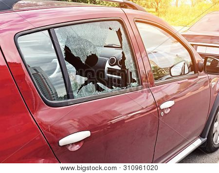 Broken Glass On The Passenger Door Of A Passenger Car Parked. The Concept Of Crime Of Car Theft, The