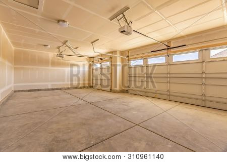 Interior Of The Empty Garage Of A Home With Unfinished Walls And Ceiling