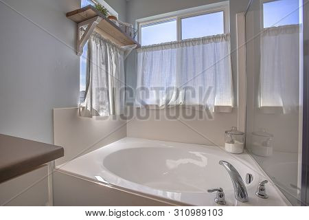 Bathroom Interior With Close Up View Of The Gleaming Built In Bathtub