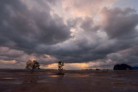 Rainy Clouds Over An Open Area Of Low Tide.