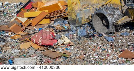 Close Up Of Bulldozer Working On The Huge Household Garbage Landfil, Ecologic Problem, Environmental