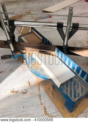 Shot Of A Floor Tile Cutting Equipment. Ceramic Tile Cutting By Manual Tile Cutter. A Carbide Roller