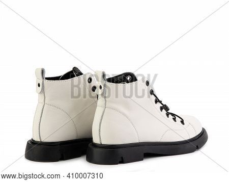 White Leather Ankle Boots With Black Laces And Black Rubber Sole. Isolated Close-up On White Backgro
