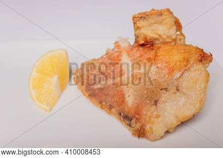 Battered Fish Fillet Isolated Over White Background.
