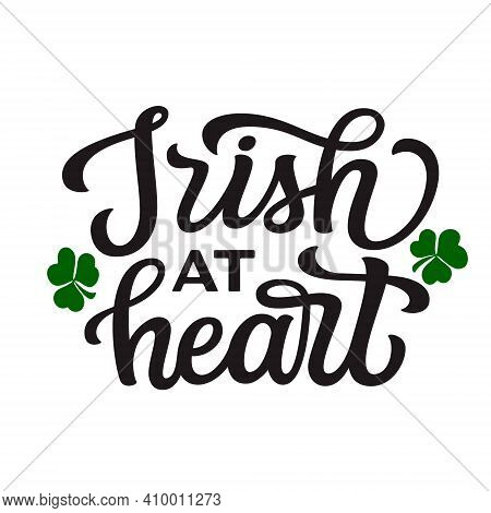 Irish At Heart. Hand Lettering Quote Isolated On White Background. Vector Typography For St. Patrick