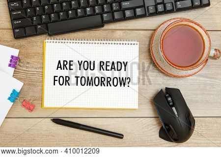 Office Desk And Notebook With Text Are You Ready For Tomorrow, Keyboard And A Cup Of Tea