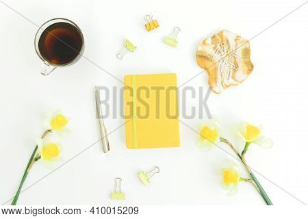 Resin Art With Diary, Cup Of Tea, Clips, Pen And Narcissus On White Background. Flat Lay, Top View