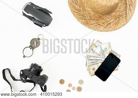 Travel Concept With Drone, Straw Hat, Photo Camera, Vintage Compass And Usa Cash On White Background