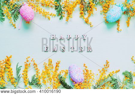 Easter background, Easter 2021. Easter eggs, Easter mimosa flowers, Happy Easter inscription, festive Easter card, colorful Easter eggs, Easter holiday background, Easter pattern, festive Easter design