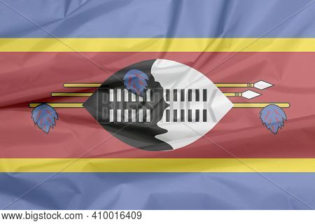 Fabric Flag Of Swaziland. Crease Of Swazi Flag Background, Blue Yellow And Red With The Large Black