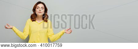 Woman In Yellow Blouse Standing With Closed Eyes And Meditating On Grey, Banner.