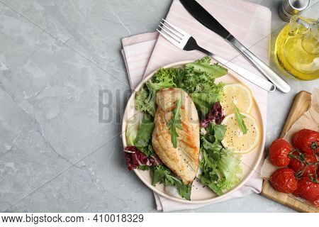 Delicious Cooked Chicken And Fresh Salad Served On Grey Marble Table, Flat Lay With Space For Text.