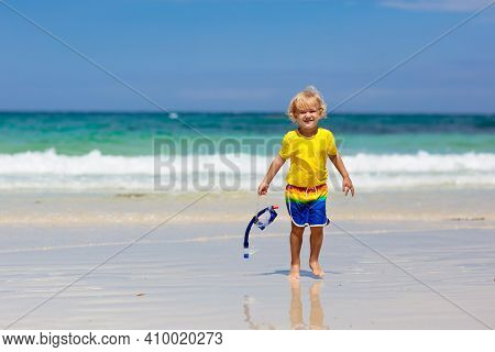 Child Snorkeling On Tropical Beach. Kids Snorkel In Ocean On Family Summer Vacation On Exotic Island