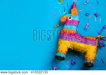 Llama Shaped Pinata, Streamers And Glitter On Light Blue Background, Flat Lay. Space For Text