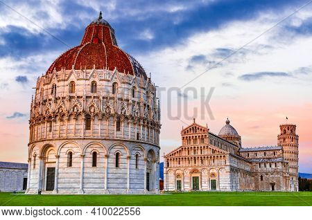 Pisa, Italy. Blue Hour Twilight With Campo Dei Miracoli And World Famous Leaning Tower Travel Backgr