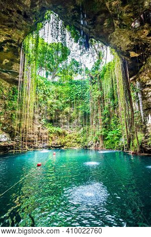 Ik-kil Cenote, Mexico. Lovely Cenote In Yucatan Peninsulla With Transparent Waters And Hanging Roots