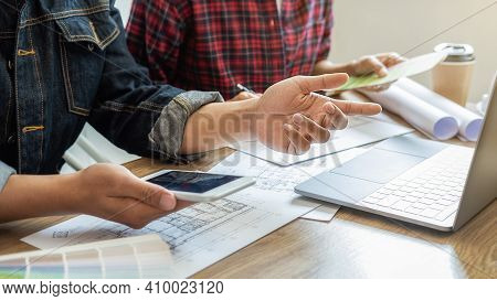 Interior Designer And Architect Choosing Color In Color Swatch Samples Chart For House Coloring Sele