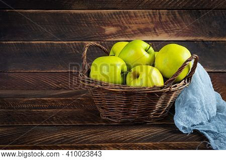Ripe Green Apples On A Wooden Background. Delicious Juicy Apples