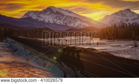 Pickup On Road And Mountains Winter Time Photo.
