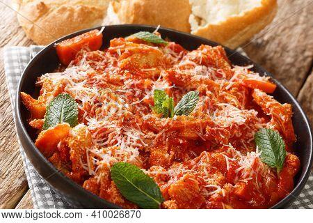 Italian Roman Tripe Trippa Alla Romana Closeup In The Plate On The Table. Horizontal