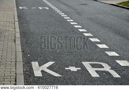 Parking Along The Sidewalk With A Sign Car And Ride. Serves To Combine Car And Public Transport. An