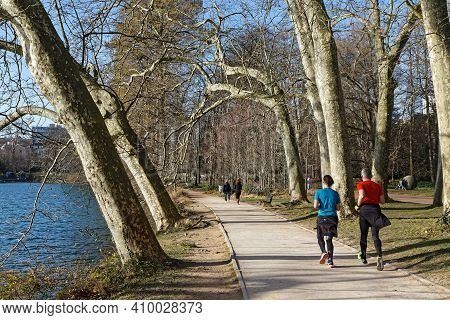 Lyon, France, February 20, 2021 : Walk, Running Or Biking Are Usual Activities All Around The Alleys