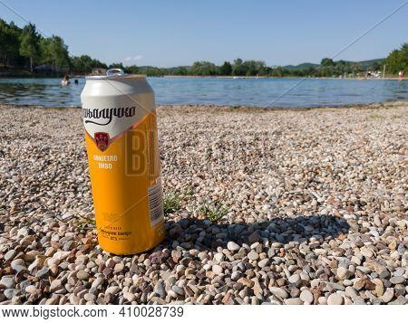 Bosnia And Herzegovina - June 27, 2020: Banjalucko Beer On The Beach Next To The Artificial Lake Man