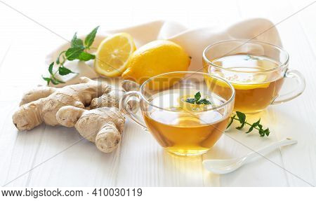 Herbal Ginger Tea For Boost Your Immune. Two Glass Mugs Of Healthy Hot Drink Close-up