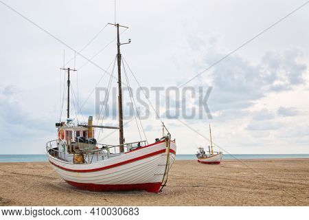 In absence of a harbor, fishing boats are towed onto the beach of Slettestrand