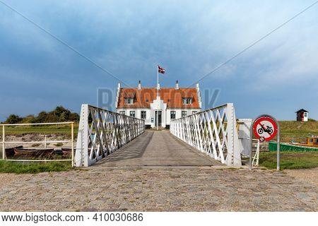 Denmarks oldest swing bridge crossing Frederik VII's canal and Limfjord museum building at Løgstør, Denmark