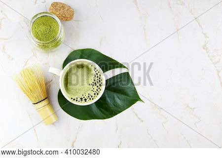 Matcha Tea Drink. The Concept Of The Japanese Tea Ceremony. Green Matcha Powder And Bamboo Whisk For
