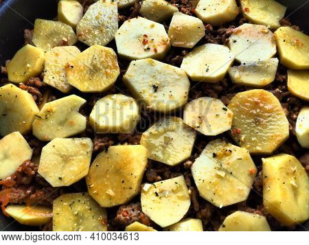 Raw Potatoes, Cut Into Circles And Stacked On Top Of Minced Meat And Onions. Moussaka Making Process