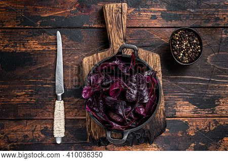 Swiss Red Chard Or Mangold Salad Leafs In A Pan. Dark Wooden Background. Top View