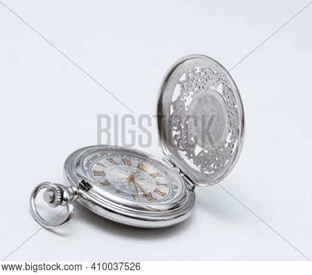 Beautiful Silver Pocket Watch Close Up On White Background