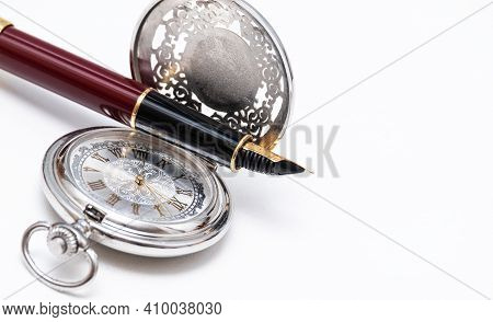 Beautiful Pocket Watch And Fountain Pen Close Up On On White Background