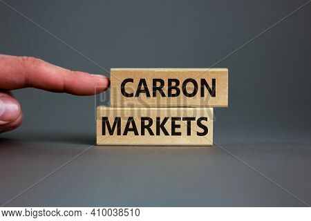 Carbon Markets Symbol. Concept Words 'carbon Markets' On Wooden Blocks On A Beautiful Grey Backgroun
