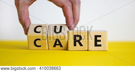 Cure And Care Symbol. Doctor Turns Wooden Cubes And Changes The Word 'care' To 'cure'. Business, Med