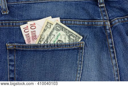 Money In Your Pocket. Bills In The Back Pocket Of Jeans. The Concept Of Pocket Money. Cash.
