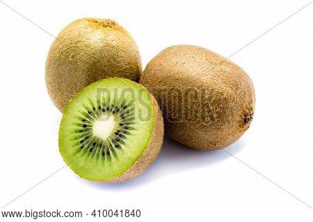 Two Kiwi Fruits And A Sliced kiwi Isolated On White Background