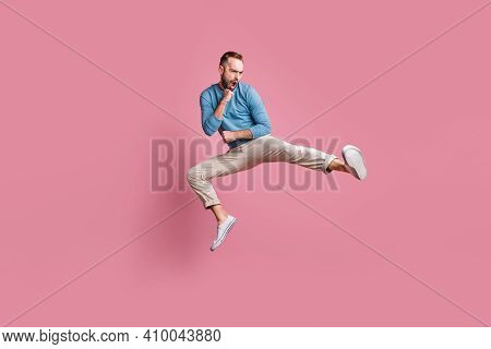 Full Length Photo Of Cute Strong Young Man Dressed Blue Sweater Jumping High Practicing Karate Isola