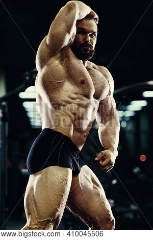 Bodybuilder Handsome Strong Athletic Rough Man Pumping Up Abs Muscles Workout Fitness And Bodybuildi