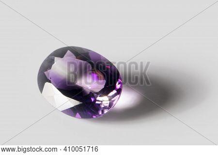 Large Polished Amethyst Gemstone Close-up On White Background. Close Up.
