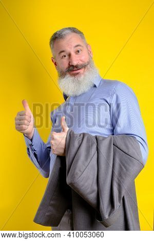 Studio Portrait Mature Businessman Dressed In Gray Suit Shows Thumbs Up, Successful Business Concept