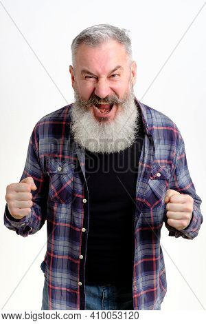 Mature Man With Fists Defense Gesture, Angry And Upset Man Over White Backdrop, Ready To Fight, Afra