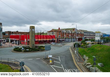 Rhyl, Denbighshire; Uk: Feb 21, 2021: A General Street Scene Showing  The Clock Tower Roundabout Wit