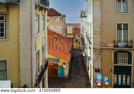 Lisbon, Portugal - November 14, 2014: Steep Narrow Street Of Lisbon City, Portugal.